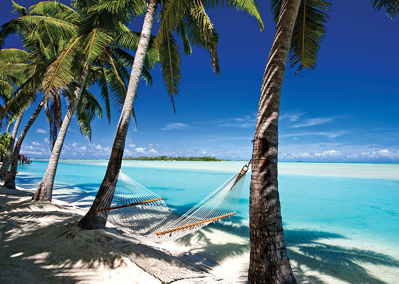 Photo Credit David Kirkland - Relaxing on a deserted beach, Aitutaki - Cook Islands