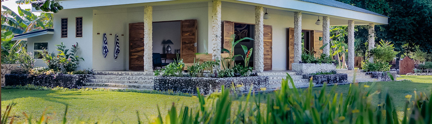 Seaview Suite - Gardens, lawn and exterior view of beautiful stone wall building - Nakatumble Luxury Eco Villa - Vanuatu Holiday Homes